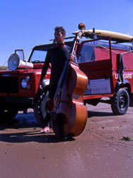 Steve Tucker with bass and lifeguard truck